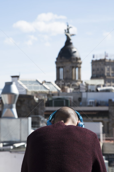 young man using headphones in Barcelona, Spain Stock photo © nito