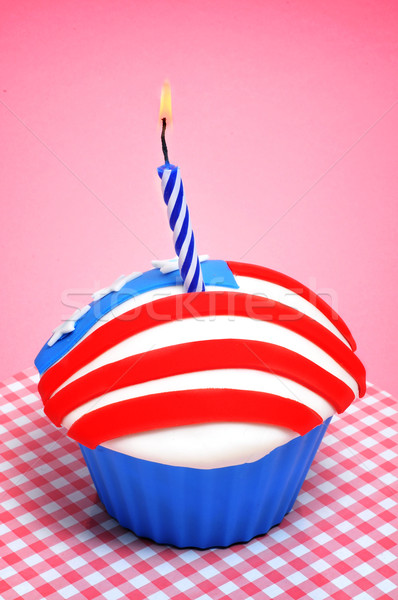Stock photo: american cupcake with candle