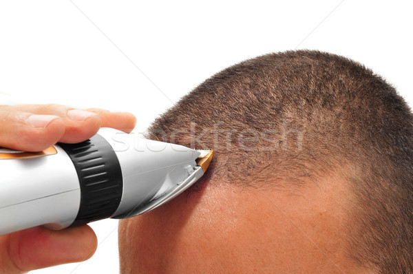 man cutting his hair with an electric hair clipper Stock photo © nito