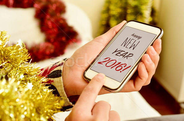 text happy new year 2016 in the smartphone of a man Stock photo © nito