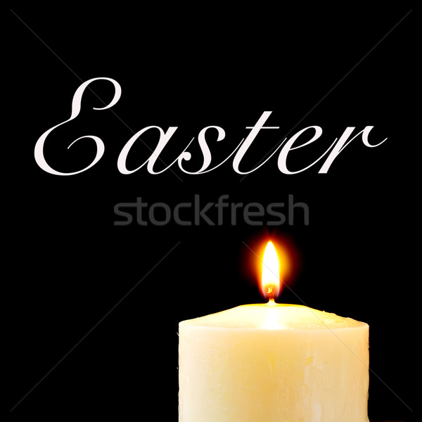 a lit candle and the text easter Stock photo © nito