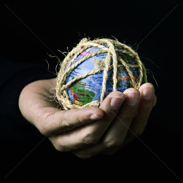 man with a world globe tied with rope Stock photo © nito
