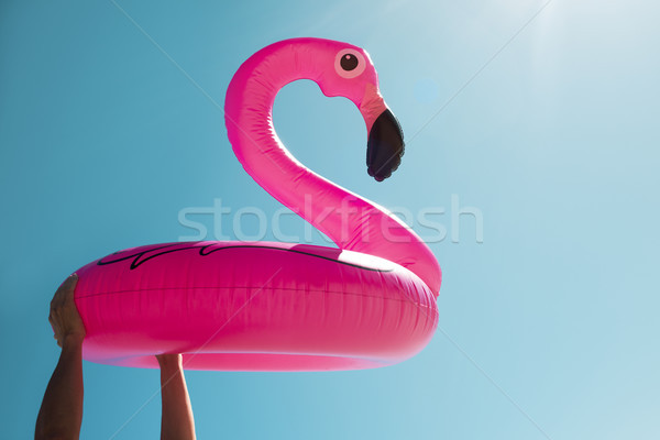 man with a pink flamingo swim ring Stock photo © nito