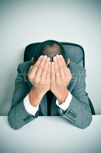 businessman with his hands in his head Stock photo © nito
