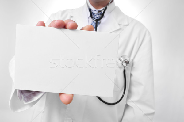 doctor showing a blank signboard Stock photo © nito