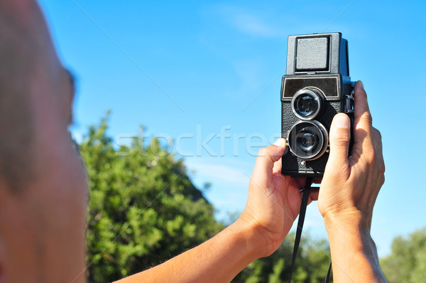 young man taking a selfie with an old medium format camera Stock photo © nito