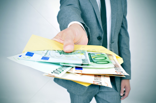 Homme enveloppe plein euros costume Photo stock © nito