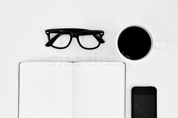 blank notebook, eyeglasses, cup of coffee and smartphone on a wh Stock photo © nito