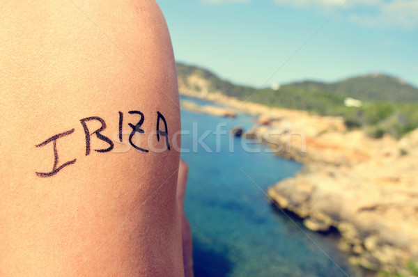 young man with the word Ibiza written in his arm Stock photo © nito