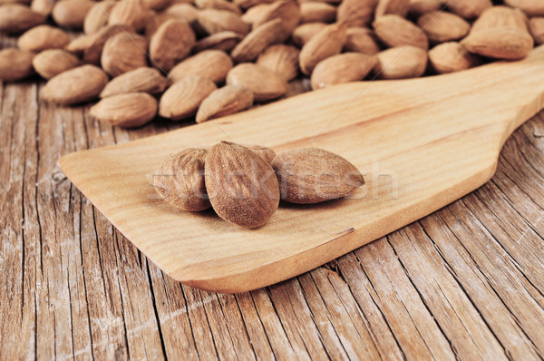 shelled almonds on a wooden table Stock photo © nito