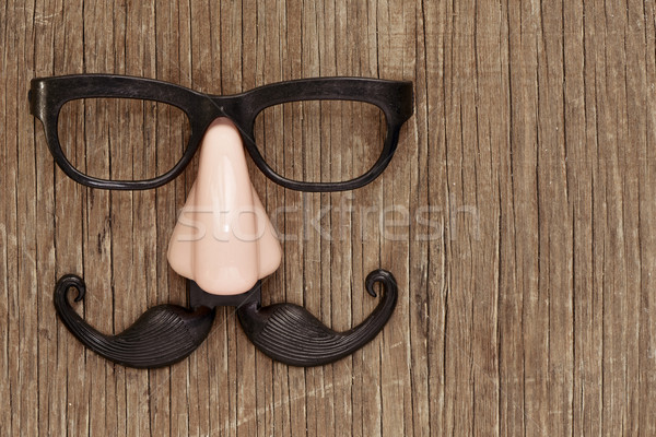 fake mustache, nose and eyeglasses on a wooden surface Stock photo © nito