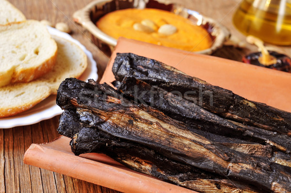 barbecued calcots, sweet onions, and romesco sauce typical of Ca Stock photo © nito
