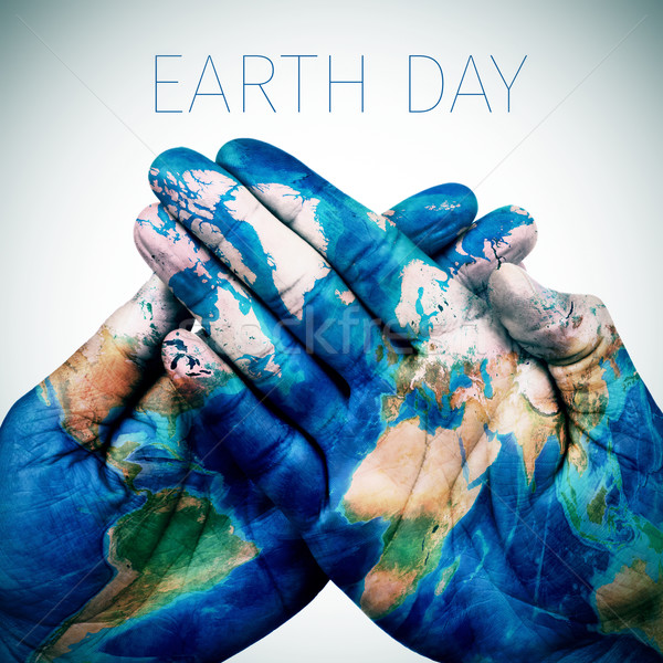 text earth day and man hands patterned with a world map (furnish Stock photo © nito