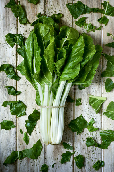 raw chard leaves on a rustic white table Stock photo © nito