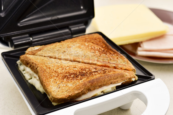 toasted sandwiches in a sandwich toaster Stock photo © nito