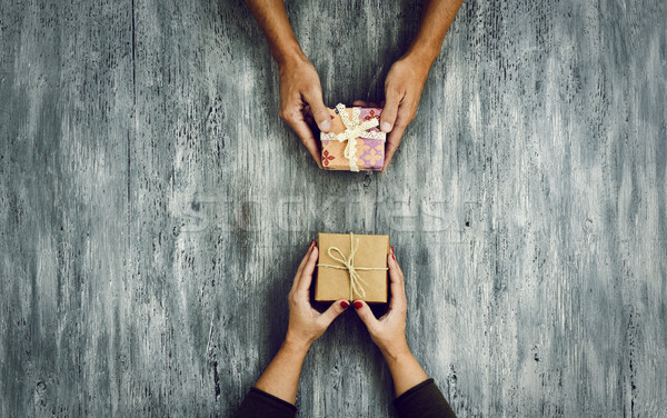 woman and man exchanging gifts Stock photo © nito