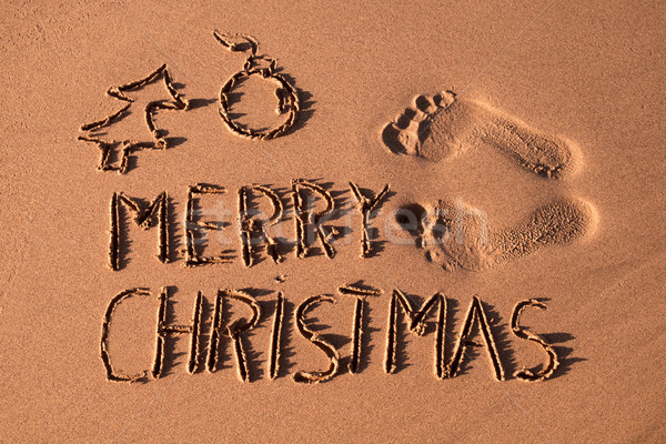 text merry christmas in the sand of a beach Stock photo © nito