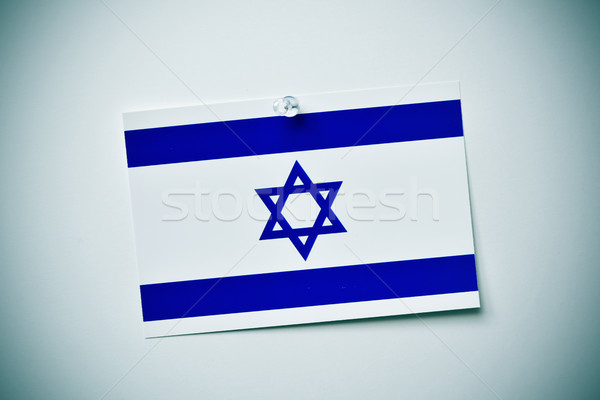 Stock photo: flag of israel pinned on a wall