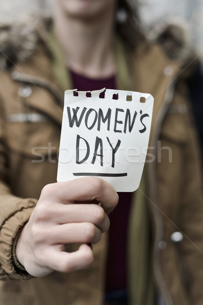 woman with a note with the text womens day Stock photo © nito