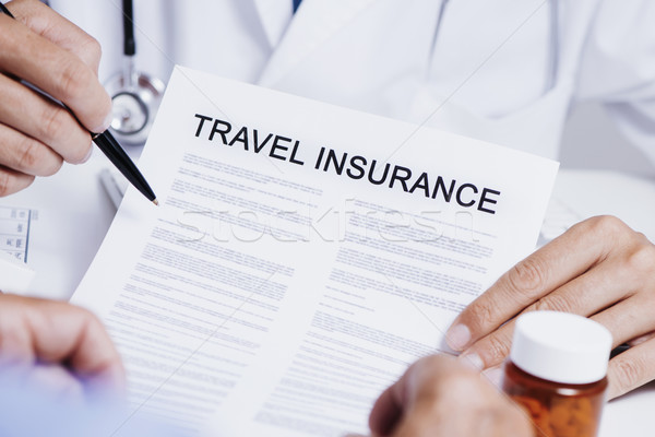 doctor showing a travel insurance policy to a man Stock photo © nito
