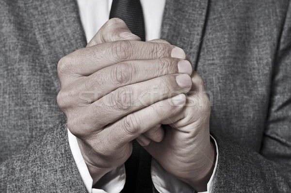 man in suit rubbing his hands Stock photo © nito