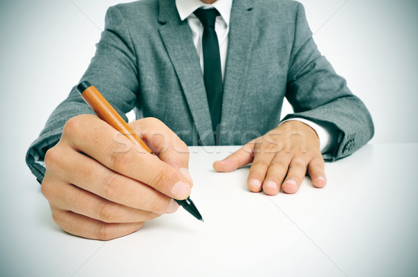 man in suit with a pen in his hand ready to write Stock photo © nito