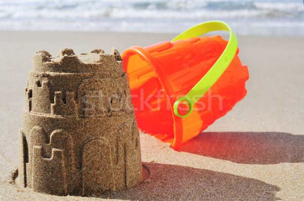 Jouet seau sandcastle sable plage orange Photo stock © nito