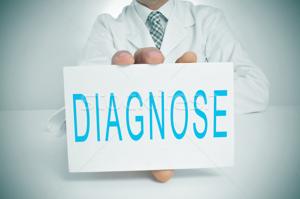Diagnózis férfi visel fehér kabát ül Stock fotó © nito