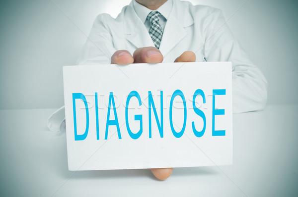Diagnose Mann tragen weiß Mantel Sitzung Stock foto © nito