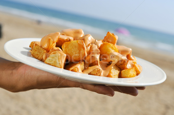 typical spanish patatas bravas, fried potatoes with a hot sauce, Stock photo © nito