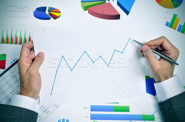 businessman observing a chart with an upward trend Stock photo © nito