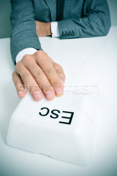 man pressing a giant escape key Stock photo © nito