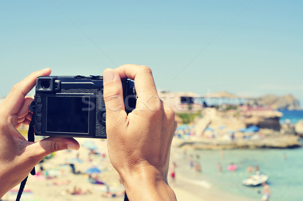 man taking a picture at Cala Conta beach in San Antonio, Ibiza I Stock photo © nito