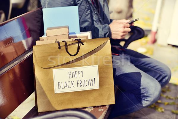 человека смартфон сумку текста счастливым черная пятница Сток-фото © nito