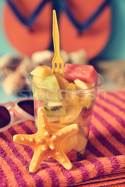 fruit salad, sunglasses, beach towel and flip-flops Stock photo © nito