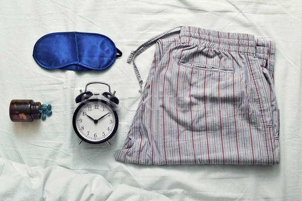 sleep mask, sleeping pills, alarm clock and pajamas Stock photo © nito
