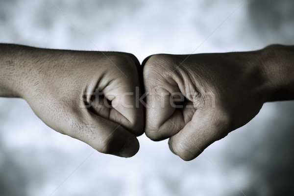 Deux hommes poing mains deux jeunes Photo stock © nito