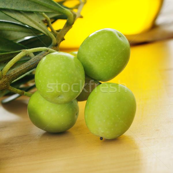 ág olajfa olívaolaj közelkép fa asztal üveg Stock fotó © nito