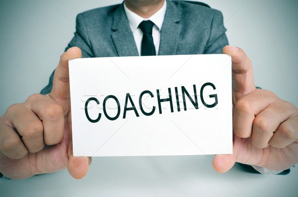 man with a signboard with the word coaching Stock photo © nito