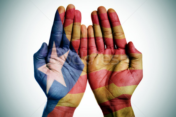 man hands patterned with the Catalan pro-independence flag Stock photo © nito