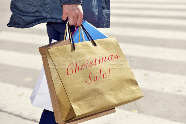 man with a bag with the text christmas sale Stock photo © nito