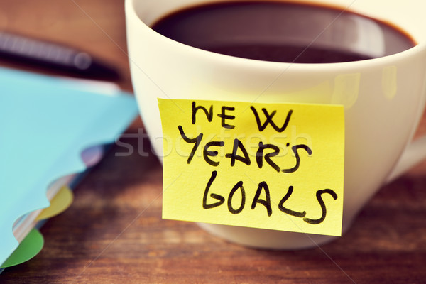 coffee and a sticky note with the text new years goals Stock photo © nito