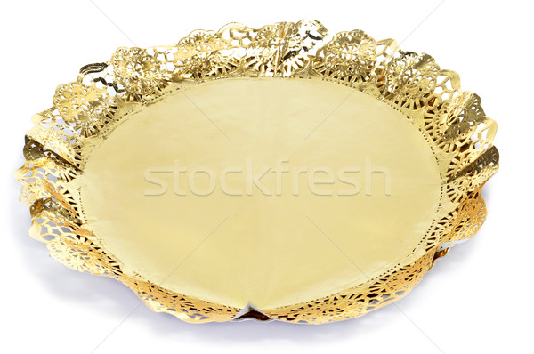 golden paper lace doily on a cake board Stock photo © nito