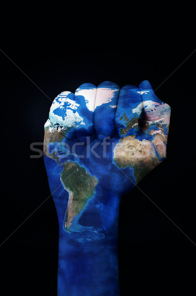 raised fist patterned with a world map (furnished by NASA) Stock photo © nito