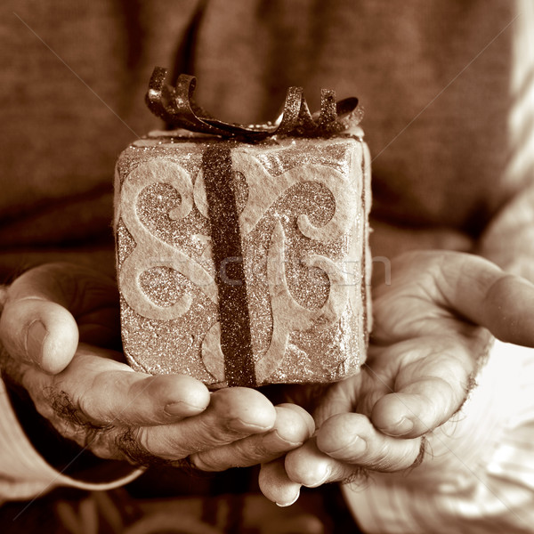 old man with a gift, in sepia toning Stock photo © nito