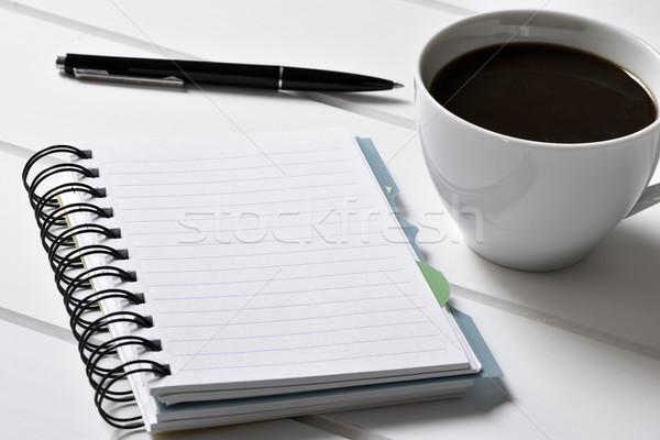 Foto d'archivio: Notebook · pen · Cup · caffè · bianco · tavola