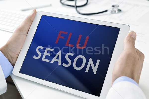 doctor and tablet with the text flu season Stock photo © nito