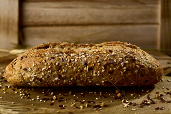 wholemeal bread roll topped with different seeds Stock photo © nito