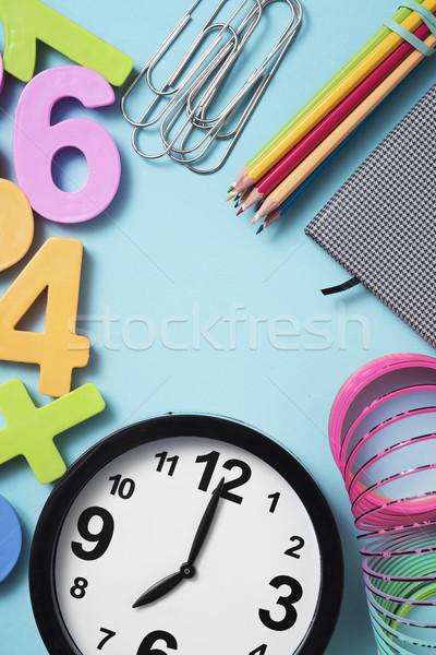 school supplies and clock at seven Stock photo © nito