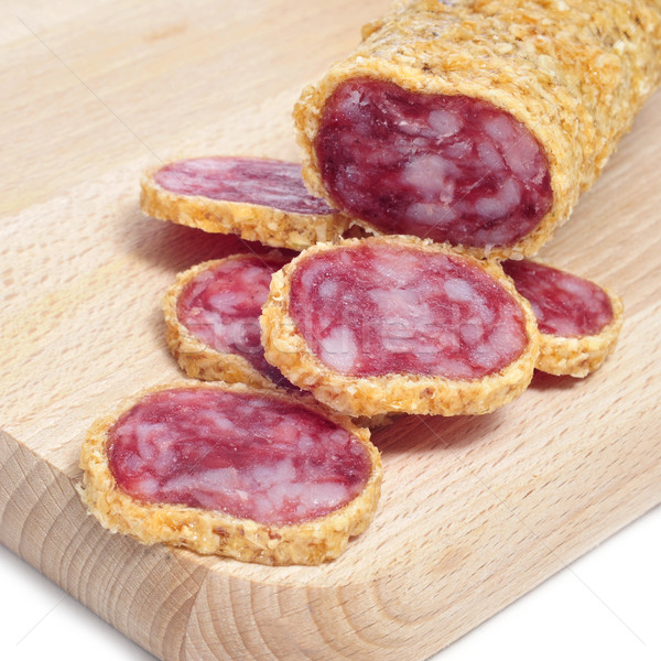 fuet, spanish sausage, coated with onion Stock photo © nito